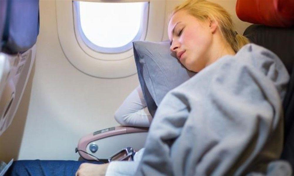 Dormir en el avión